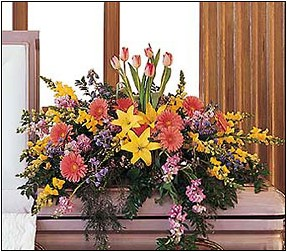 Blooming Glory Casket Spray by Inglis Florists